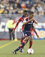 New England Revolution forward Jerry Bengtson (27) dribbles under pressure. In a Major League Soccer (MLS) match, the New England Revolution (blue) defeated Chicago Fire (red), 1-0, at Gillette Stadium on October 20, 2012.