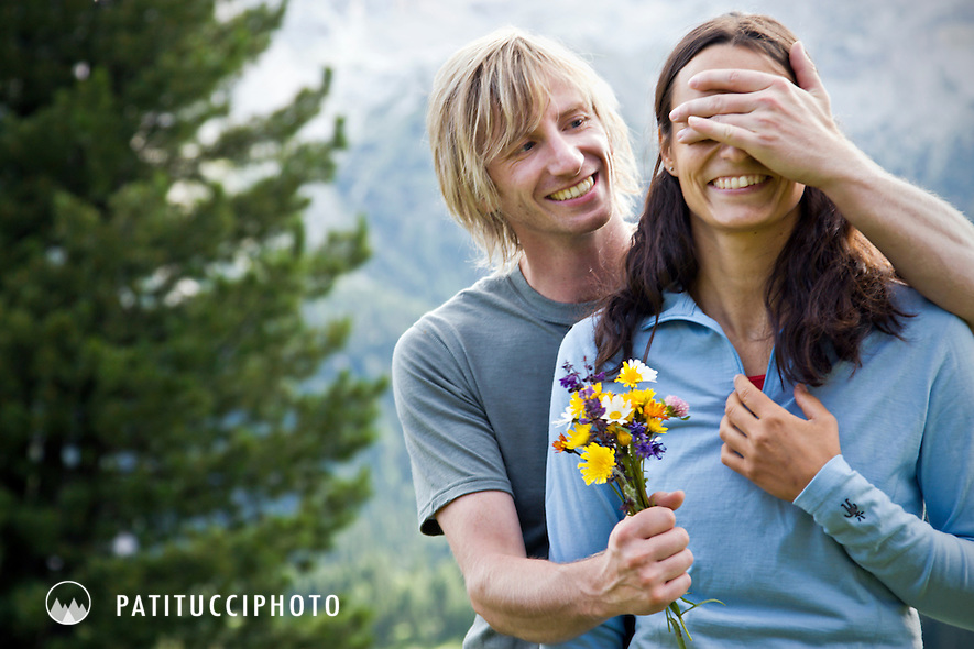 Norbert Notdurfter surprising Patrizia Taibon with a bunch of wildflowers while hiking in the Italian Dolomites