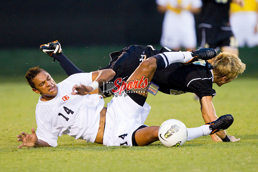 Jared Watts #2 of the Wake Forest Demon Deacons is fouled by Khiry Shelton #14 of the Oregon State Beavers at Spry Soccer Stadium on September 4, 2011 in Winston-Salem, North Carolina.  The Demon Deacons and the Beavers played to a 0-0 tie.  (Brian Westerholt / Sports On Film)
