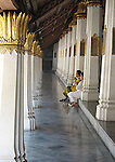 Thai women praying in The Grand Palace Temple. Bangkok, Thailand