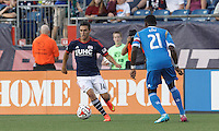 Foxborough, Massachusetts - June 28, 2014: First half action. In a Major League Soccer (MLS) match, the New England Revolution (dark blue/white) vs Philadelphia Union (blue/white), 0-1, at Gillette Stadium.