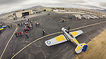 Open House at the WInnemucca Airport as photographed using the DJI Phantom quadcopter drone and GoPro Hero 3 camera from above the event. <br /> <br /> Aircraft on the ramp&ndash;North American T-6 Texan, WWII-era fighter/trainer with RAF colors