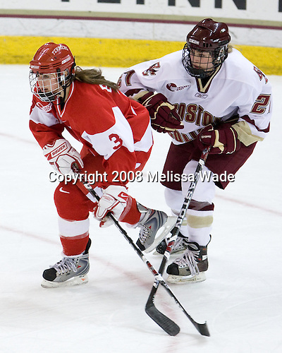Kasey Boucher (BU - 3), Andrea Green (Boston College - 21) - The Boston University Terriers defeated the Boston College Eagles 4-1 on Saturday, November 22, 2008, at Conte Forum in Chestnut Hill, Massachusetts.