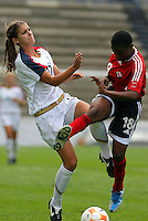 Alex Morgan of USA (L) and Jannelle Cunningham of Trinidad and Tobago (R), during CONCACAF U-20 Women's World Cup qualifying tournament in Puebla, Mexico. The USA defeated Trinidad and Tobago, 4-0.