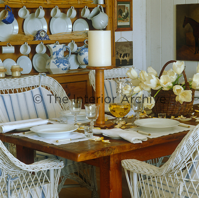 Blue and white china and co-ordinating stripes give this dining room a contemporary yet rustic feel