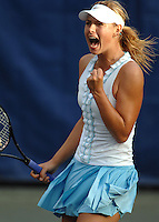 Maria Sharapova celebrates after winning match point in a third set tie-breaker during her dramatic come-from-behind victory over Anabel Medina Garrigues during play in the Bausch & Lomb Championships at Amelia Island Plantation. Fl. (The Florida Times-Union, Rick Wilson)