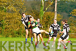 Padraig King St Michael's Foilmore wins the ball ahead of Ardfert's  Brian Moloney and Brian O'Sullivan during their Senior County Championship relegation play off in Listry on Saturday..