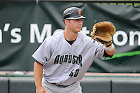 Catcher Jared Deacon (40) of the Augusta GreenJackets warms up before a game against the Greenville Drive on Sunday, April 12, 2015, at Fluor Field at the West End in Greenville, South Carolina. Augusta won, 2-1. (Tom Priddy/Four Seam Images)