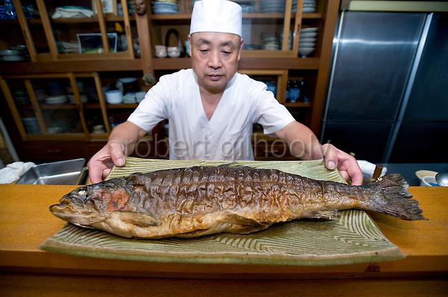 Yasuhiro Iwami displays a rainbow trout, the speciality of his restaurant Kagetsu in Fujinomiya, Shizuoka Prefecture Japan on 02 Oct. 2012.  Photographer: Robert Gilhooly