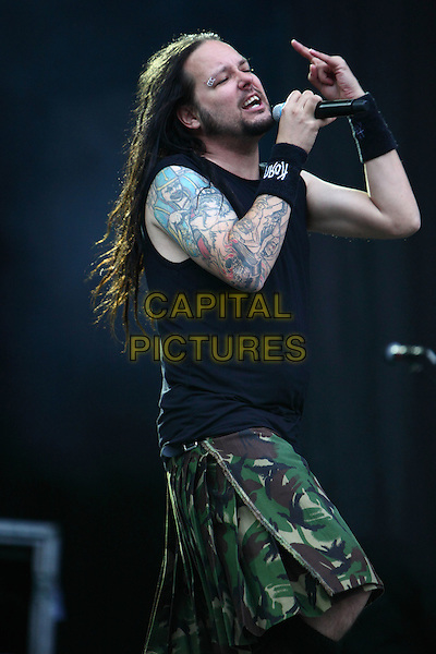 Korn.Concert in Moscow, Russia..July 8th, 2009.on stage in concert live gig performance performing music half length black sleeveless top tattoos green camouflage skirt singing .CAP/PER/SB.© SB/Persona/CapitalPictures
