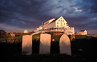 The 1875 Oceanic Hotel is the main building of the Star Island Conference Center, Islesof Shoals, off the coast of New Hampshire. Caswell cemetery in the foreground. Photograph by Peter E. Randall.