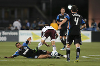 San Jose Earthquakes defender Jason Hernandez (21) slide tackles Colorado Rapids midfielder Wells Thompson (15) during the Colorado Rapids 2-1 victory over the San Jose Earthquakes at Buck Shaw Stadium in Santa Clara, California.