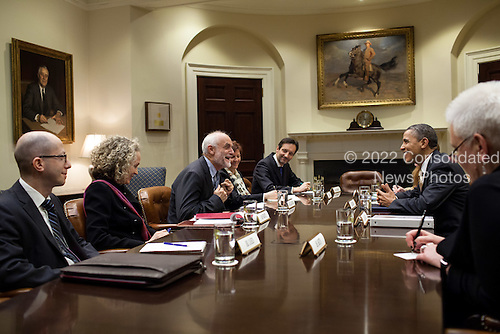 United States President Barack Obama drops by a meeting with Jakob Kellenberger, President of the International Red Cross, center, and representatives from the International Red Cross, in the Roosevelt Room of the White House, March 29, 2012. .Mandatory Credit: Pete Souza - White House via CNP