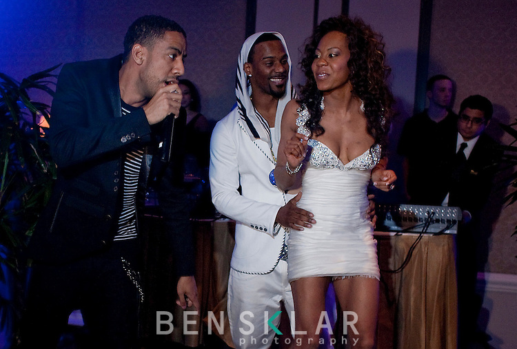 "Pop star Ryan Leslie entertains Ross and Richards during the after party. Leslie sang two songs including ""Diamond Girl."" Olympic gold medalist, Sanya Richards, and New York Giants cornerback, Aaron Ross, wed at the Hyde Park Baptist in Austin, Texas on Friday, February 26, 2010..."