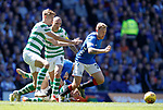 12.05.2019 Rangers v Celtic: Scott Arfield beats Kristoffer Ajer and Scott Brown