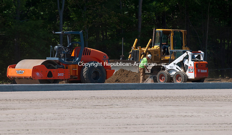 TORRINGTON, CT 081814JS05--Work continues on the new track and filed complex at Torrington High School in Torrington on Monday. <br /> Jim Shannon Republican-American