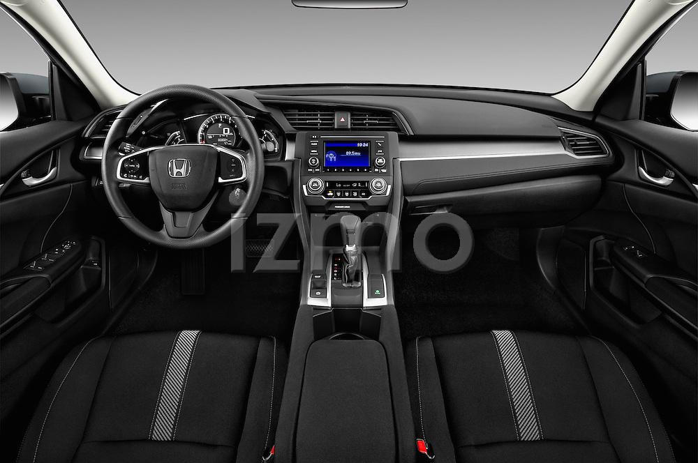 Stock photo of straight dashboard view of 2018 Honda Civic LX 4 Door Sedan Dashboard