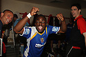 Yemi Odubade of Stevenage Borough celebrates winning promotion in the changing room after the Blue Square Premier match between Kidderminster Harriers and Stevenage Borough at the Aggborough Stadium, Kidderminster on Saturday 17th April, 2010..© Kevin Coleman 2010