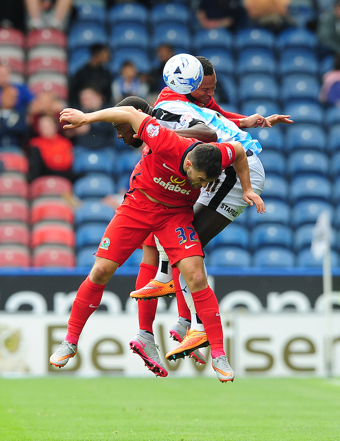 Blackburn Rovers' Craig Conway, front, vies for possession with Huddersfield Town's Ishmael Miller and Blackburn Rovers' Marcus Olsson<br /> <br /> Photographer Chris Vaughan/CameraSport<br /> <br /> Football - The Football League Sky Bet Championship - Huddersfield Town v Blackburn Rovers - Saturday 15th August 2015 - The John Smith's Stadium - Huddersfield<br /> <br /> &copy; CameraSport - 43 Linden Ave. Countesthorpe. Leicester. England. LE8 5PG - Tel: +44 (0) 116 277 4147 - admin@camerasport.com - www.camerasport.com