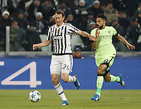 Calcio, Champions League: Gruppo D - Juventus vs Manchester City. Torino, Juventus Stadium, 25 novembre 2015. <br /> Juventus&rsquo; Stephan Lichsteiner, left, is challenged by Manchester City's Gael Clichy during the Group D Champions League football match between Juventus and Manchester City at Turin's Juventus Stadium, 25 November 2015. <br /> UPDATE IMAGES PRESS/Isabella Bonotto