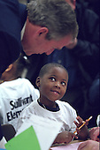 United States President George W. Bush talks with a student at Sullivant Elementary School Columbus, Ohio on Tuesday, February 20, 2001. .Mandatory Credit: Paul Morse - White House via CNP