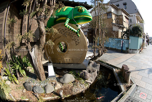 "February 14, 2013, Kawagoe, Japan - A big statue of Chameleon on five Yen coin at Little Edo, Kawagoe. An old town from Edo Period (1603-1867) is located in Kawagoe, 30 minutes by train from central Tokyo. In the past Kawagoe was an important city for trade and strategic purpose, the shogun installed some of their most important loyal men as lords of Kawagoe Castle. Every year ""Kawagoe Festival"" is held in the third weekend of October, people pull portable shrine during the parade, later ""dashi"" floats on the streets nearby. The festival started 360 years ago supported by Nobutsuna Matsudaira, lord of Kawagoe Castle. (Photo by Rodrigo Reyes Marin/AFLO).."