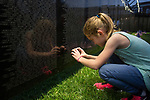 "Hope Goodson, 9, of Wilkesville, takes a photo of ""The Wall That Heals"", a half-scale replica of the Vietnam Veterans Memorial in Bicentennial Park on September 15, 2017."