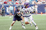 Ron John (#33) works against Jason Alessi  (#45) as Yale defeats UAlbany 20-11 in the NCAAA semifinal game at Gillette Stadium, May 26.