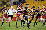 Ben Meyer is taken by the cover defence. Counties Manukau Steelers vs Bay of Plenty Steamers warm up game played at Mt Smart Stadium on 14th of July 2006. Counties Manukau won 25 - 20.