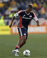 New England Revolution defender Andrew Farrell (2) crosses the ball. In a Major League Soccer (MLS) match, the New England Revolution (blue) tied New York Red Bulls (white), 1-1, at Gillette Stadium on May 11, 2013.