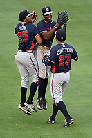 Outfielders from the Rome Braves celebrate a 10-7 win over the Greenville Drive on Tuesday, May 30, 2017, at Fluor Field at the West End in Greenville, South Carolina. From left are Cristian Pache, Justin Ellison and Anthony Concepcion. (Tom Priddy/Four Seam Images)