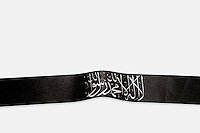 A black headband with religious writing is one of a number of items of clothing and objects found in an Islamic clothing and accessory shop in the Bagicilar district of Istanbul.