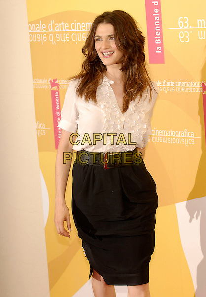 "RACHEL WEISZ.""The Fountain"" photocall.63rd Venice International Film Festival.Venice, Italy.4th September 2006.Ref: KRA.half 3/4 length white cream ruffle shirt blouse high waisted skirt black belt.www.capitalpictures.com.sales@capitalpictures.com.©Persun/Capital Pictures"