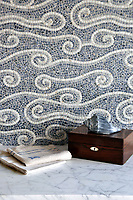 Eddies, a hand chopped natural stone mosiac shown in 1cm Blue Bahia, Bardiglio, and Carrara, is part of the Metamorphosis Collection by Sara Baldwin for New Ravenna Mosaics.