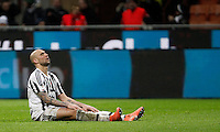 Calcio, Coppa Italia: semifinale di ritorno Inter vs Juventus. Milano, stadio San Siro, 2 marzo 2016. <br /> Juventus&rsquo;s Simone Zaza sits on the pitch during the Italian Cup second leg semifinal football match between Inter and Juventus at Milan's San Siro stadium, 2 March 2016.<br /> UPDATE IMAGES PRESS/Isabella Bonotto