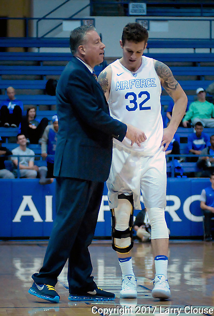 January 24, 2017:  Air Force head coach, Dave Pilipovich, gives instructions to Falcon forward, Ryan Manning #32, during the NCAA basketball game between the San Diego State Aztecs and the Air Force Academy Falcons, Clune Arena, U.S. Air Force Academy, Colorado Springs, Colorado.  Air Force defeats San Diego State 60-57.