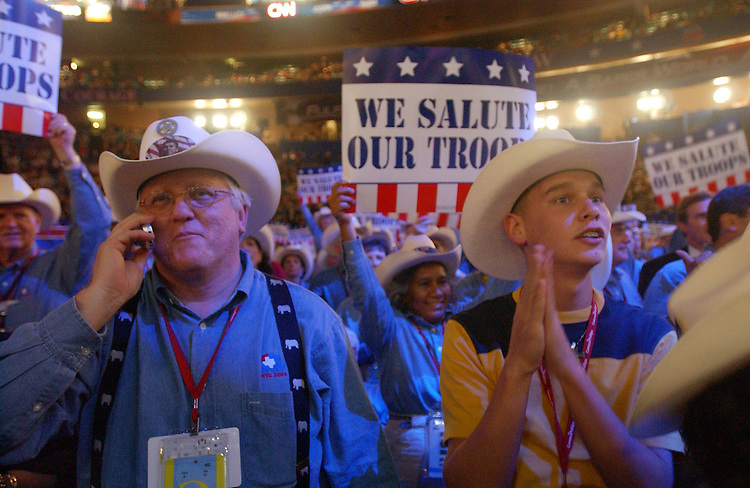 8/30/04/04.2004 REPUBLICAN NATIONAL CONVENTION/TEXAS DELEGATES--Texas delegates Ken Leonard and Joel Fisher, both alternates, celebrate on the convention floor..CONGRESSIONAL QUARTERLY PHOTO BY SCOTT J. FERRELL