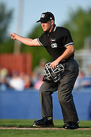 Umpire Chris Scott signals fair ball during a game between the Staten Island Yankees and Batavia Muckdogs on August 6, 2014 at Dwyer Stadium in Batavia, New York.  Batavia defeated Staten Island 5-3.  (Mike Janes/Four Seam Images)