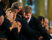 Boston, MA - August 29, 2009 -- U.S. Senator Edward Kennedy's sons Edward Kennedy jr. (L) and Congressman Patrick Kennedy  (R) hug after Patrick Kennedy spoke . during funeral services for U.S. Senator Edward Kennedy at the Basilica of Our Lady of  Perpetual Help in Boston, Massachusetts August 29, 2009.  Senator Kennedy died late Tuesday after a battle with cancer. .Credit: Brian Snyder- Pool via CNP