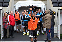 Wednesday, 23 April 2014<br /> Pictured: Swansea players hold back to allow Ashley Williams (FRONT) to take to the pitch first.<br /> Re: Swansea City FC are holding an open training session for their supporters at the Liberty Stadium, south Wales,