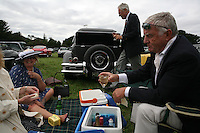 Goodwood Revival, 2007.Champagne breakfeast. The Goodwood revival is one of the largest historic car races events in the world; 3 days of racing at the highest level with some of the best pilots past and present driving historically important cars to the limit...and sometimes beyond! 110 000 spectators and participants gather in period costumes for a unique event.
