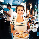 Veselka restaurant, a Ukranian diner on New York City's Lower East side, serves up traditional Eastern European cuisine, including cheese blintzes.  Here a waitress holds a plate of this signature dish.