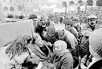 27 dicembre 1984, Piazza Maggiore a Bologna: funerali delle vittime della strage del Rapido 904 nota come strage di Natale. Famigliari di una delle vittime.<br /> December 27, 1984, Piazza Maggiore in Bologna: funeral of the victims of the Rapido 904 massacre known as Christmas massacre. Family of one of the victims.