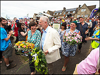 BNPS.co.uk (01202 558833)<br /> Pic: PhilYeomans/BNPS<br /> <br /> Earlier in the march Corbyn was cheered by the crowds.<br /> <br /> There was no escape for beleaguerd Labour leader Jeremy Corbyn even in the bucolic surroundings of the Tolpuddle Martyrs rally in the heart of Dorset.<br /> <br /> Labour Party member Claire Cavendish climbed a gravestone to deliver a vitriolic attack on the controversial leader , demanding he should step down, just after he had laid a wreath on a martyrs grave in the village churchyard.<br /> <br /> Jeremy Corbyn is a regular visitor to the famous rally that is seen as a key event in the founding of the Trade Union movement.