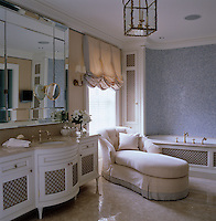 Luxurious but fresh; this chaise longue is a wonderfully opulent touch in an otherwise cool tiled bathroom
