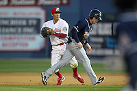 Reading Phillies shortstop Troy Hanzawa #2 tags out Brad McElroy on a steal attempt during a game against the New Hampshire Fisher Cats at FirstEnergy Stadium on April 10, 2012 in Reading, Pennsylvania.  New Hampshire defeated Reading 3-2.  (Mike Janes/Four Seam Images)
