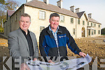 Pat Dawson,  regional manager National Parks and Wildlife service, and Harry O'Donoghue, caretaker, examine plans for the refurbishment of Killarney House.........
