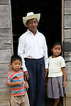 Musician and instrument maker Florencio Mess and his children near Punta Gorda, Belize