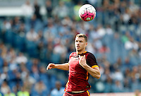 Calcio, Serie A: Lazio vs Roma. Roma, stadio Olimpico, 3 aprile 2016.<br /> Roma's Edin Dzeko in action during the Italian Serie A football match between Lazio and Roma at Rome's Olympic stadium, 3 April 2016.<br /> UPDATE IMAGES PRESS/Riccardo De Luca