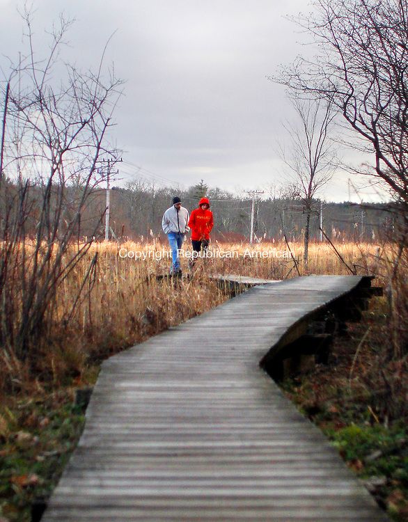 LITCHFIELD, CT. 24 NOVEMBER 2012 - 112412JW01 -- Jon Lebrecque and Jill Goldfarb of Torrington enjoy a walk on the boardwalk through White Memorial Conservation Center Saturday afternoon..Jonathan Wilcox Republican-American